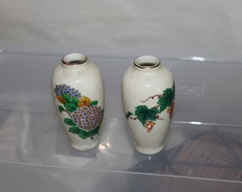 Two Vintage Japanese Vases, Small But Beautiful, The Japanese Pictures on Them are Gorgeous, They Have Gold Around The Top of Each, Matching