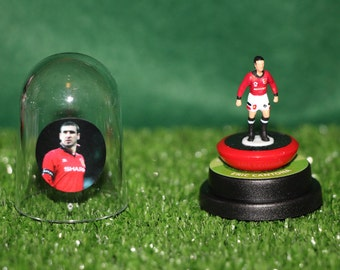 Eric Cantona (Manchester United)  - Hand-painted Subbuteo figure housed in plastic dome.