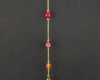 "Necklace with swarovsky beads and chain.Dangling necklace with various colored and shape beads:red,brown drop,orange,pink  beads.""Pendulum"""