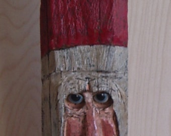 Primitive Santa carved from reclaimed fence rail