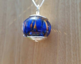 Lampwork blue & orange flame Wire Wrapped pendant