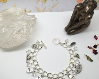 Filled with joy! Charm bracelet with positive words and glass crystals
