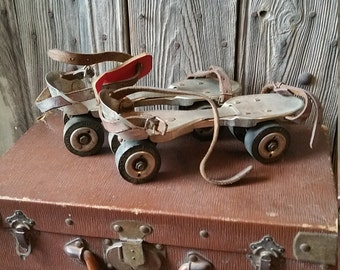 Vintage Pair of French Extendable Roller Skates with Original Leather Straps