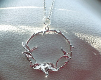 Silver Plated Round Pendant Charm Necklace consisting of a unique branches and leaves design