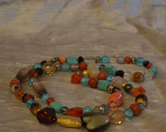 Handmade necklace of semiprecious stones, coral, murano glass beads and other components