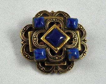 Original by Robert brass/blue stone pin