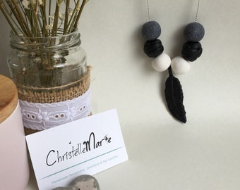 Black, grey & white Polymerclay beaded necklace with clay feather