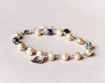 Delicate natural pearls and garnet bracelet, Wire wrapped beaded pearl bracelet, leaf charm, Garnet nugget, hematite, Gift for her