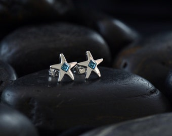 Star stud earrings with blue coloured Swarovski crystals