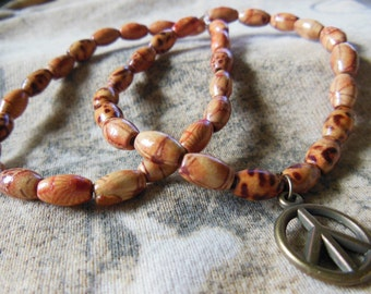 2 wooden bead bracelets with Peace charm