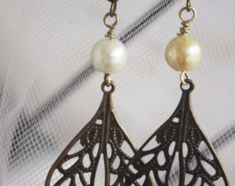 large metal dangle earrings with pearl accents