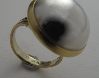Silver and 18 kt gold ring