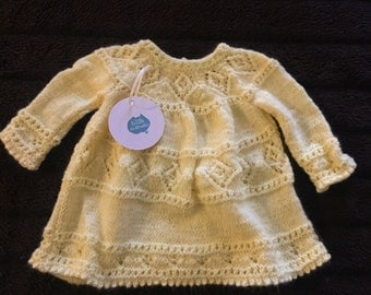 Yellow hand-knitted baby dress
