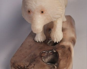 Alaskan Native carved Ivory Wolf on a fossilizrd Ivory base