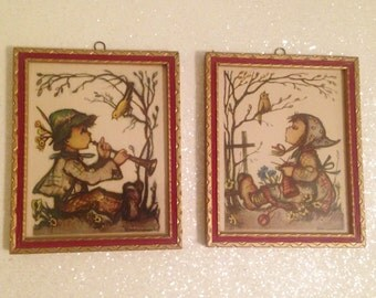 Set of Two Small Hummel Prints of a Boy and a Girl in Matching Red & Gold Frames