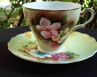Vintage Hand Painted Porcelain Flower and Gold Accent Teacup and Saucer