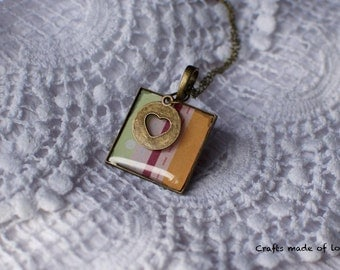Pendant with heart charm