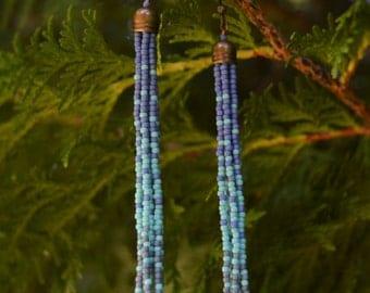 Blue Bayou. Blue Blends Tassel Shoulder Dusters. Hand Woven Seed Bead Earrings