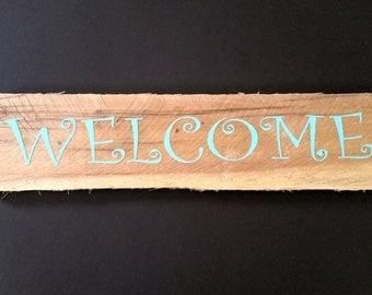 Painted wooden welcome sign