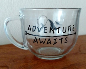 "Glass Mug ""Adventure Awaits"" with mountains"