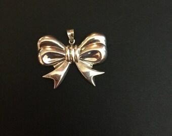 Big silver bow pendant