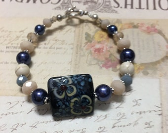 Beaded Handmade Bracelet w/ Hand Painted Center Stone, Navy pearl, Neutral Crystal, & Silver Findings