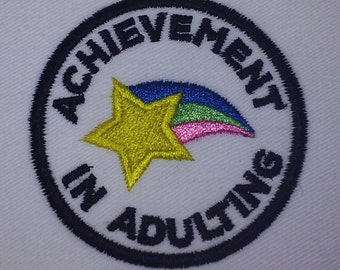 Achievement in adulting patch on white canvas