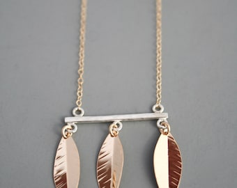 mixed metal modern necklace with leaves in 14k gold filled and sterling silver, Rachel Wilder Handmade Jewelry