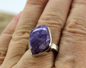 Genuine Charoîte stone ring with a 925 sterling silver bezel mount, very good quality ring