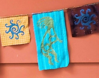 Kokopelli Southwest Petroglyph Garden and Prayer Flag Garland