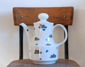 Large clouds and shapes teapot
