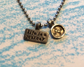 Life is a journey and compass necklace.