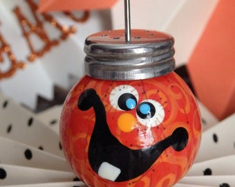 Photo Holder, Halloween Pumpkin Jack-o-lantern with Blue Eyes and One Tooth, by Stacy Marie
