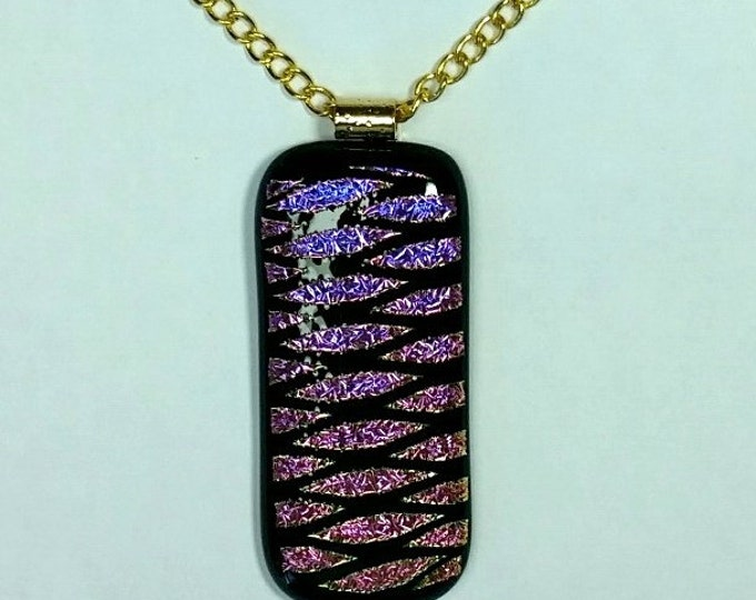 Dichroic Glass Pendant With Geometric Pattern on Black Background with Metallic Pinks