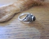 Sterling Silver and Garnet Balinese poison ring sz. 6 - for repair