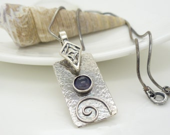 Blue iolite necklace, hammered and textured sterling silver metalwork spiral gothic pendant, dark blue oxidized silver jewelry