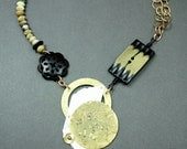 Statement silver and brass necklace by Mary Heuer