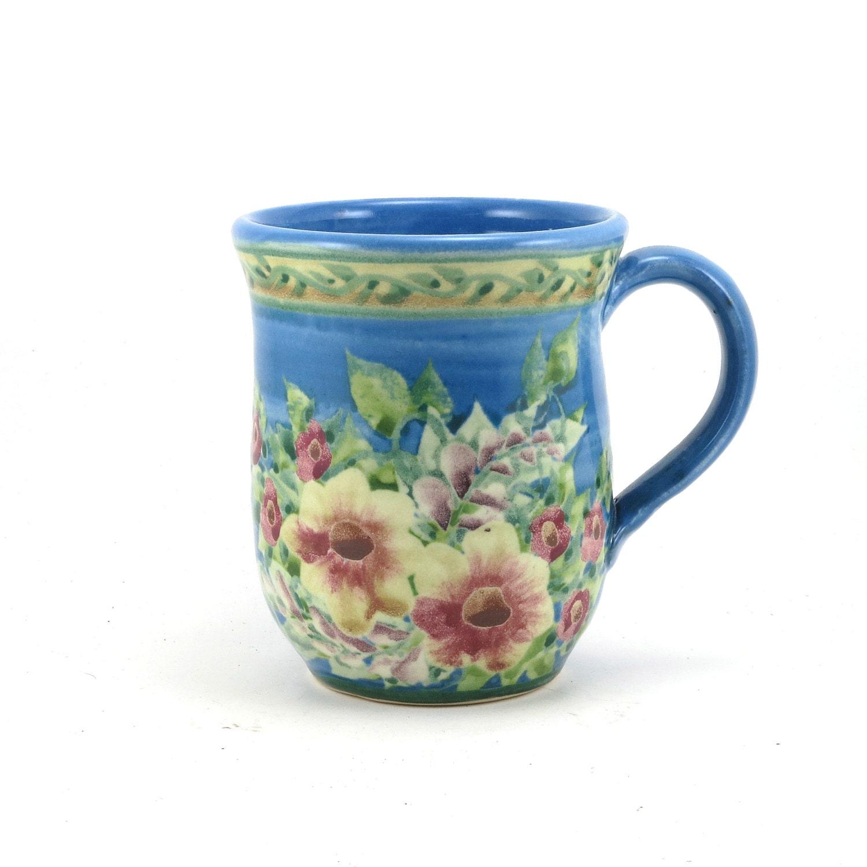 Blue porcelain coffee mug floral design blue background for Blue mug designs