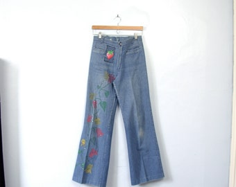 Vintage 70's hippie bellbottom jeans with strawberry patch and flowers, size 6