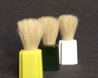 Retro shaving brush trio. Instant collection of three old brushes.