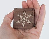 Snowflake. Wooden necklace with embroidered snowflake silhouette. White color. Eco friendly jewelry.