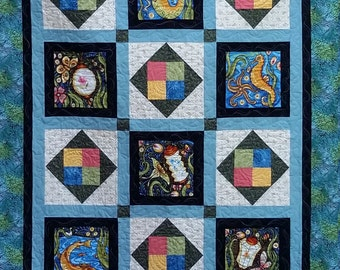 Throw Quilt featuring Luminaria by Julie Paschkis in black, blue, coral, green, and cream, mermaid quilt, one of a kind, Quiltsy Handmade