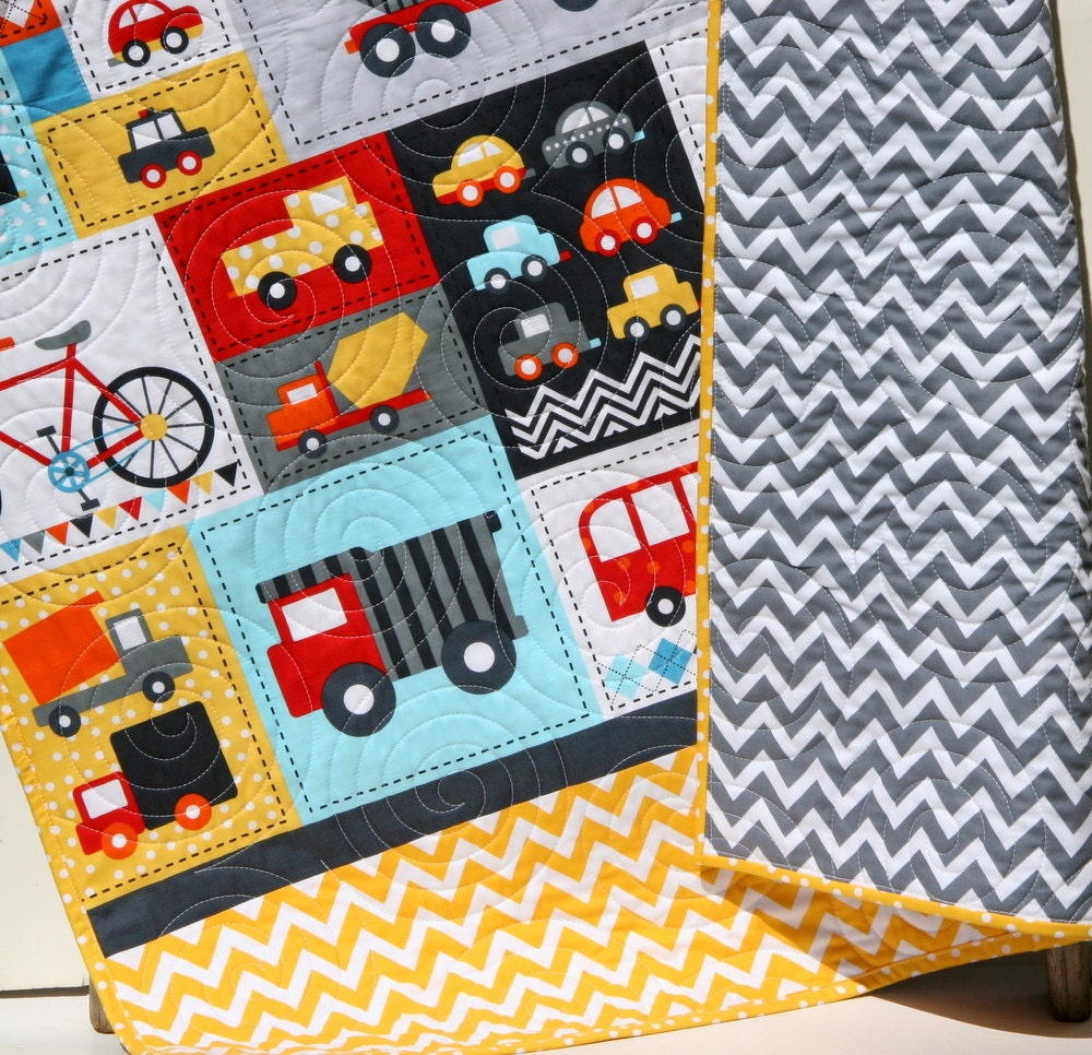 Boy quilt toddler bedding car vehicles trucks cars bikes buses for Little blue truck fabric