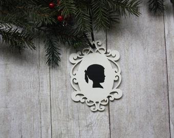 Custom silhouette cream oval laser-cut wood frame ornament