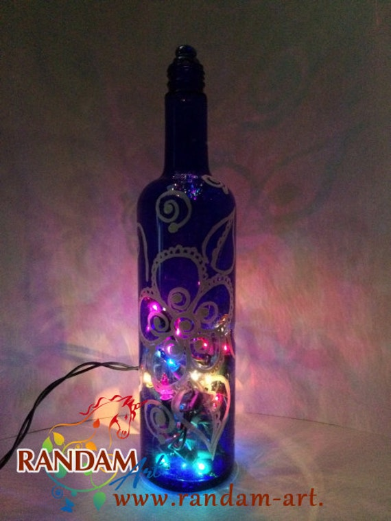 Items similar to white swirl flower on blue painted wine for Painting flowers on wine bottles