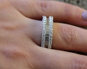 18K white gold straight baguettes and round diamonds wedding band.