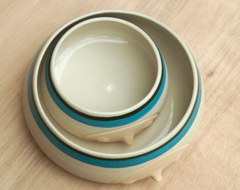 Ceramic bowl set Lagoon blue. Smiling, happy, ceramic, pottery. Hand thrown, hand sculpted, hand carved, hand painted.