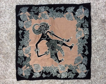 Curious Kerchief -- Black and tan scarf decorated with a mysterious humanoid