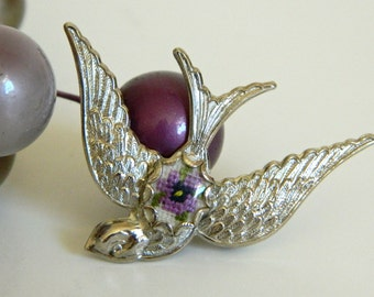 Beautiful Silver Tone Diving Sparrow Brooch with Cross Stitch Flower Detail- Bird Animal Flying Swooping Purple Nature Garden