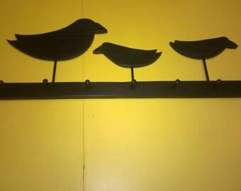 Old Black Crows on Peg Rail